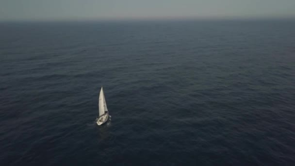 Amazing view from flying drone lonely yacht sailing in blue sea