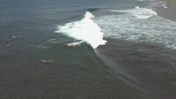 Philippines, Siargao, 26-07-2019: Track shot surfer fell down on the surfboard.