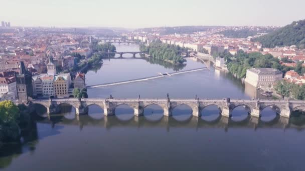 aerial view Vltava river Prague footage Czech Republic European city. top down view Karluv most canal and bridge. survey on Prague waterway. Mala Strana central Europe city. charles bridge drone shot.