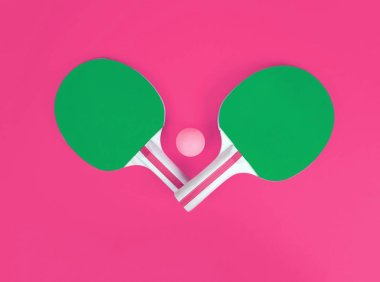 Table tennis or ping pong rackets and ball.