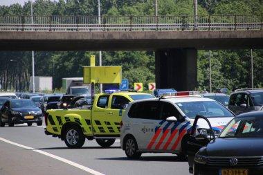 Highway marshalls of government organisation Rijkswaterstaat in action after collision on Motorway A20 at Nieuwerkerk aan den IJssel in the Netherlands
