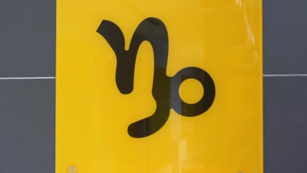 Capricorn astrological zodiac signClose-up/closeup shot of a yellow plate with Capricorn/The Goat-fish hybrid astrological sign of the zodiac