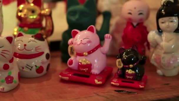 Slow motion of Japanese Lucky Cat. Maneki neko or beckoning cat in the shop. Beckoning cats are placed in front of shops for good luck and attracting customers.