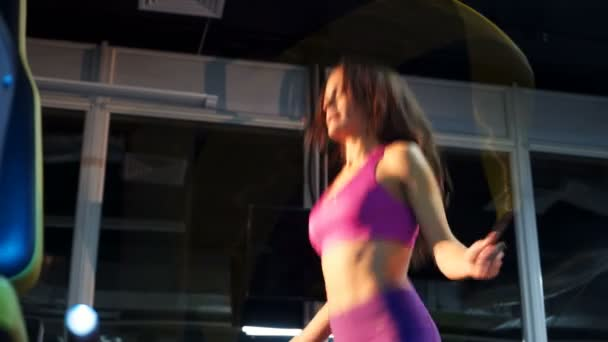Beautiful sporty woman workout with jumping rope in crossfit gym. Jump Rope.