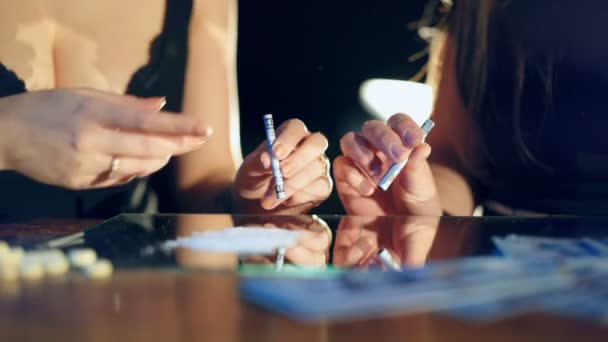 Addicted young woman is sniffing lines of drugs. Drug Abuse