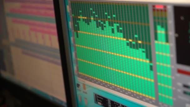Music studio audio mixer with digital display showing audio waves. Recording Studio