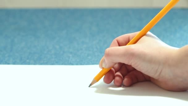 Girl doing pencil sketches on paper. Young woman learns to draw.