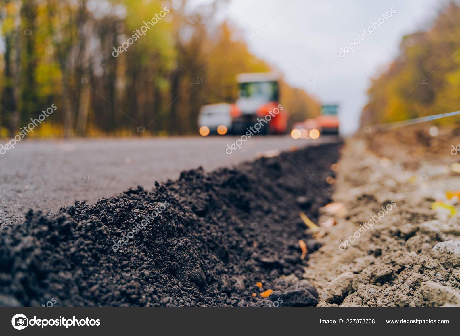 Laying New Asphalt Road Worker Operating Asphalt Paver