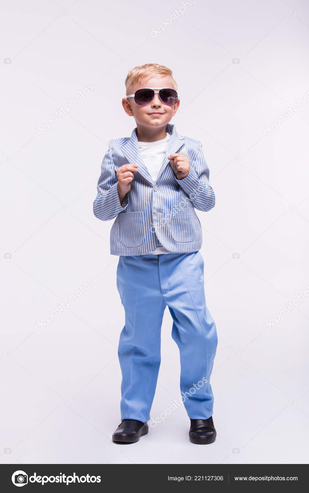 2af96b283 A cute little boy in a sunglasses and an elegant suit dancing isolated on a  white background. Happy children concept — Photo by ...