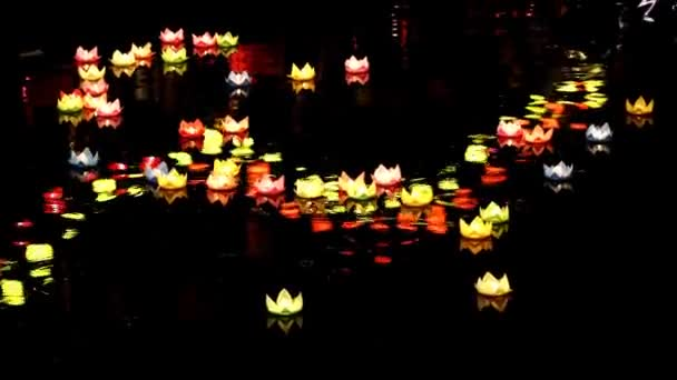 Paper Lanterns in Water shines on the river at night during the festival of the birth of Buddha. This is the traditional ritual of the Vietnamese people for peace in life