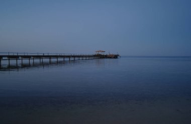 A long sea pier in the evening on the Red Sea, Egypt.