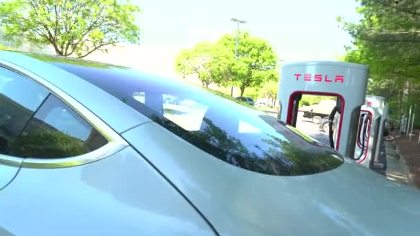 Charging a Tesla Model 3 at a Tesla Supercharger station in Raleigh, NC