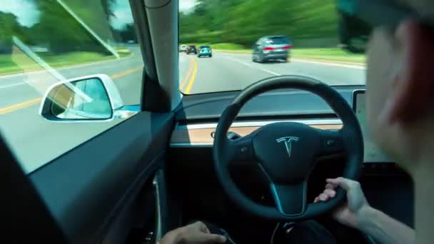 Tesla Model 3 Autopilot >> Person Driving A New Tesla Model 3 In Autopilot The Model 3 Is Set To Be The Teslas First Mass Market Electric Vehicle