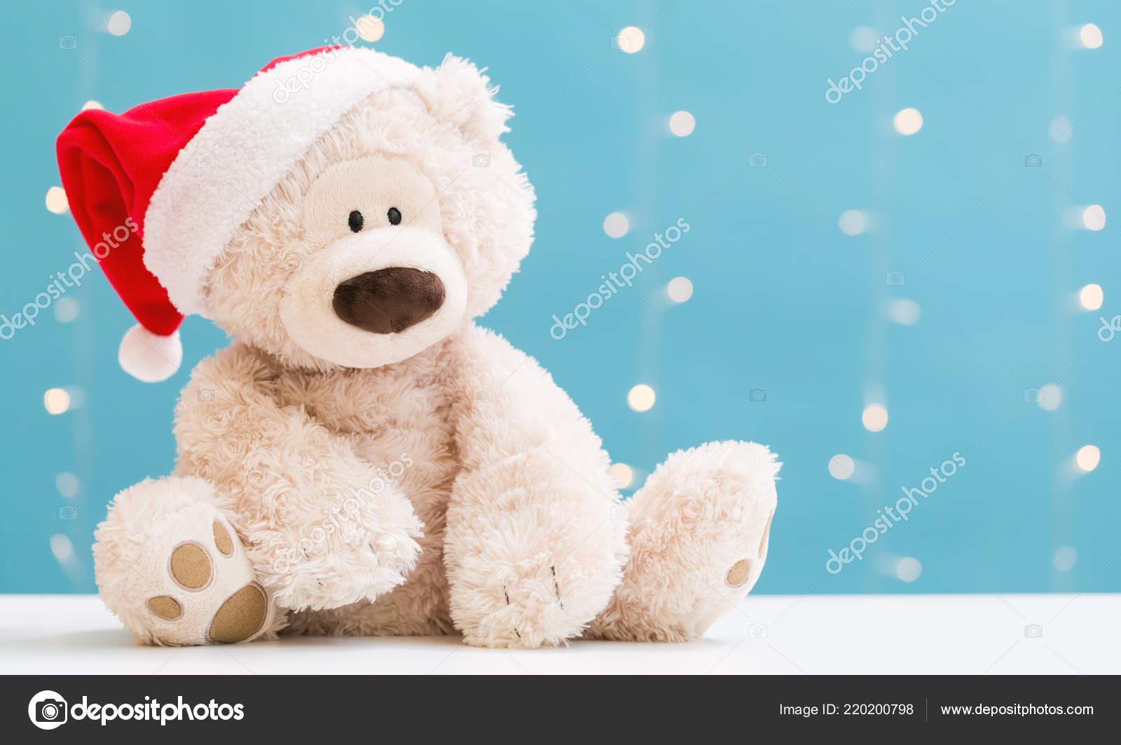 8c666e1ecc27f Teddy bear wearing a Santa hat — Stock Photo © Melpomene  220200798