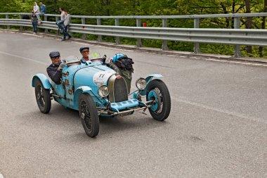 an old racing car Bugatti T 35 A (1925) runs in rally Mille Miglia 2013, the famous italian historical race (1927-1957) on May 18, 2013 in Passo della Futa (FI) Italy