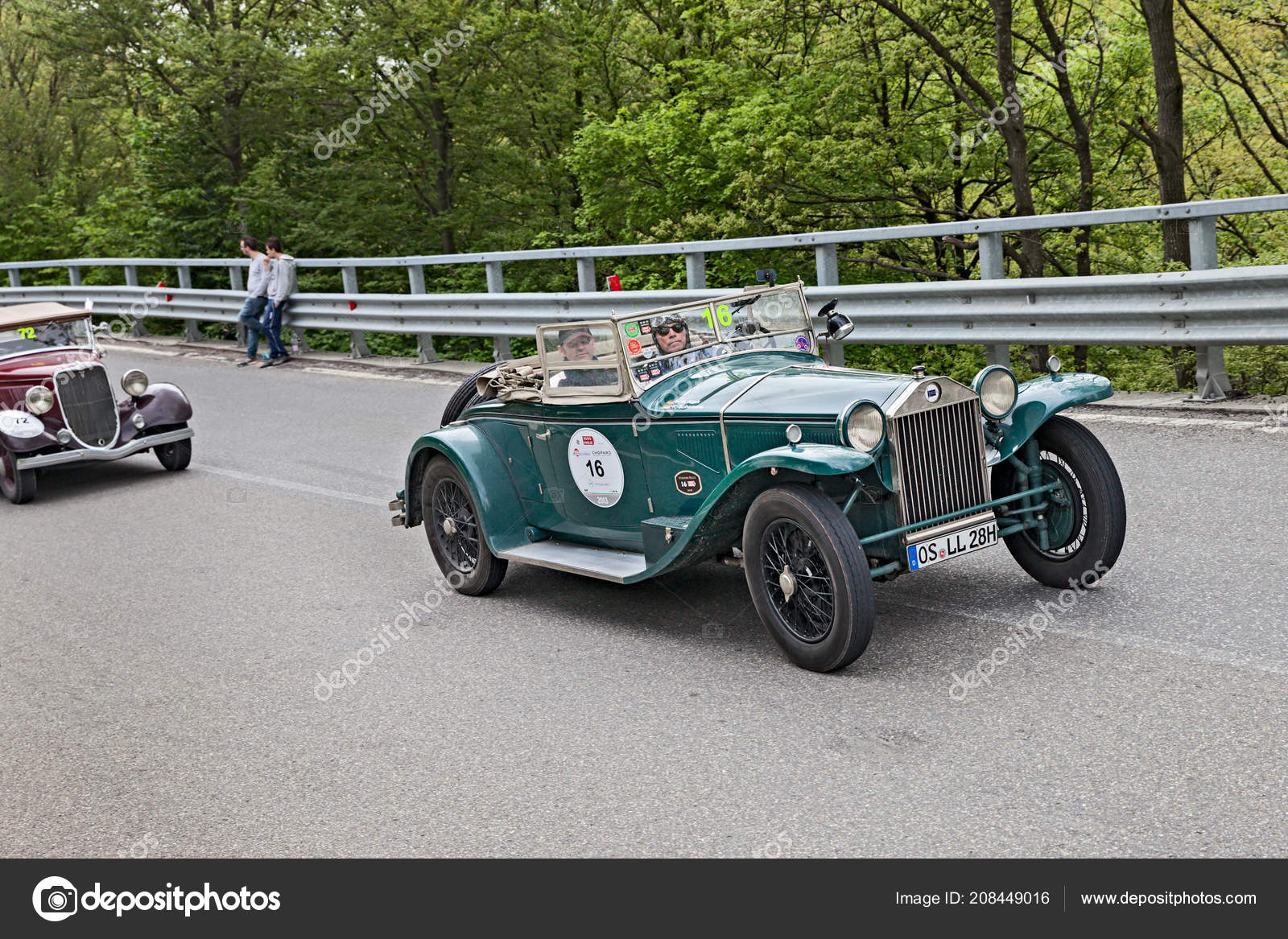 An old car Lancia Lambda 221S Series VIII Spider (1928) runs in rally Mille  Miglia 2013, the famous italian historical race (1927-1957) on May 18, ...