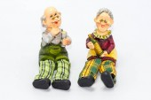 Pottery figurines of old couple drinking wine