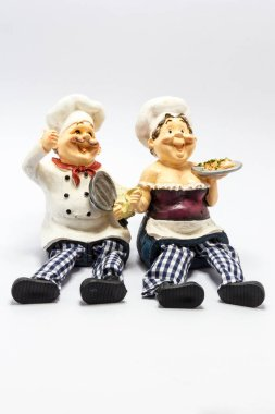 Laughing chefs with pan and plate of food pottery figurine