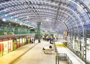 Turin, Italy - January 1, 2019. Travelers in the main hall of Porta Susa Railway Station. Turin, Piedmont, Italy.
