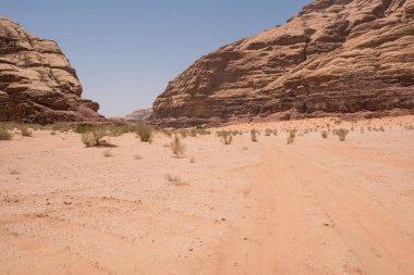 Arid desert landscape with cliffs. Burrah canyon, Wadi Rum, Jordan
