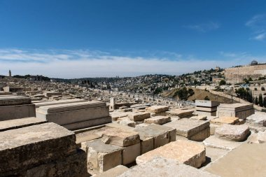 Graves in Mount of Olives Jewish Cemetery. Jerusalem, Israel. According to Jewish tradition, it is here that the Resurrection of the Dead would begin once Messiah will appear