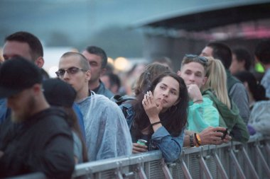 BONTIDA, ROMANIA - JULY 18, 2018: Crowd of cheerful people partying during a Damian Marley live concert at Electric Castle festival