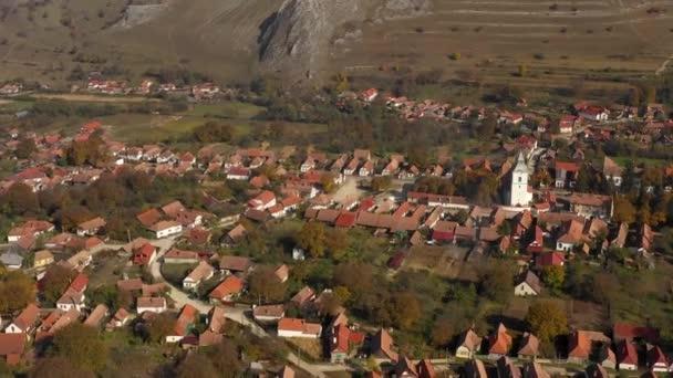 4k aerial drone movie. Flying above Rimetea (Torocko) village in Transylvania, Romania. Rooftops of traditional houses