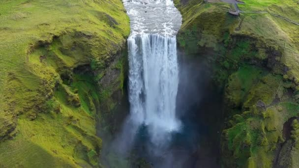 Aerial drone view of Skogafoss waterfall in Iceland, one of the country's most famous tourist attraction and landmark