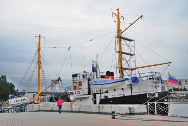 KALININGRAD, RUSSIA - AUGUST 14, 2012: World Ocean Museum, popular landmark. Several ships shown and open for visitors. Color photo.