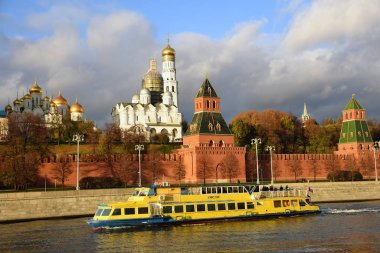 MOSCOW - OCTOBER 28, 2018: Moscow Kremlin architecture. Popular touristic landmark. Cruise ship saisl on the Moscow river. Color photo.