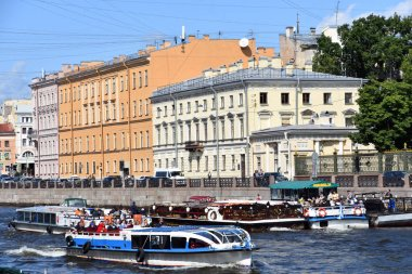 SAINT-PETERSBURG, RUSSIA - AUGUST 06, 2019: Architecture of Saint-Petersburg, Russia. The Fontanka river in the city center, popular landmark, Cruise ship sails on the river. Color photo.