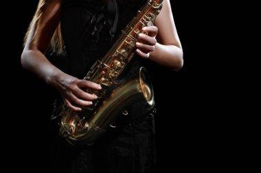 Saxophone player jazz musician saxophonist. Hands with sax music instrument closeup