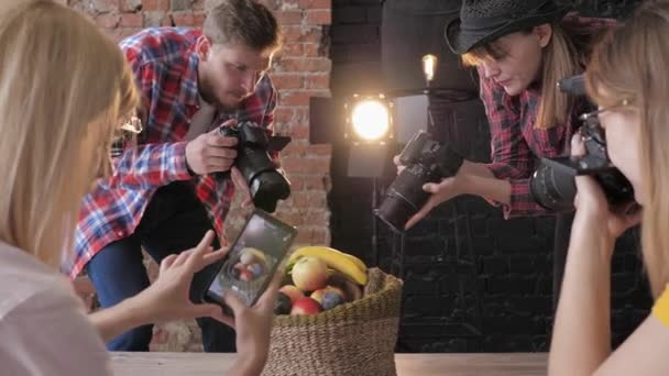 group of five photographer student learning creative still life during photo shooting on background of lighting equipment in studio