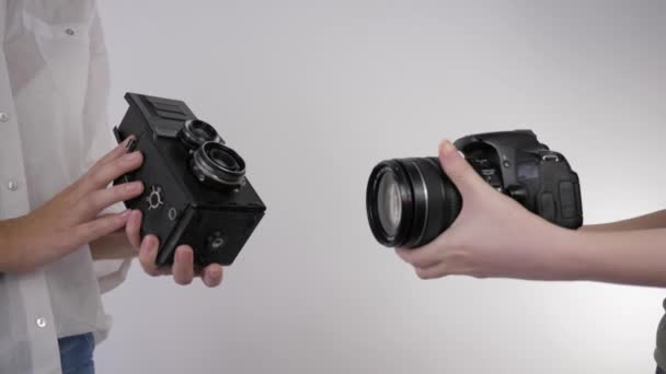 photographic equipment, comparison of a vintage camera and a modern SLR camera