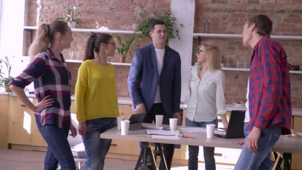portrait of successful businesspeople in modern office, Creative team men and women communication at work during break in kitchen at table