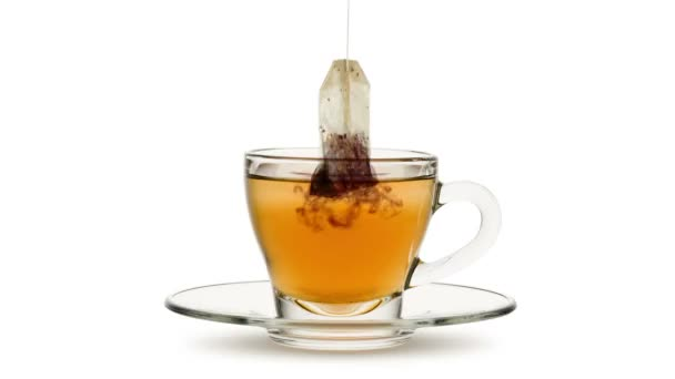Animated looping image, tea bag in infusion into glass cup of tea on white bachground.