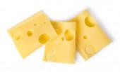 sýrové řezy izolovaných na bílém pozadí