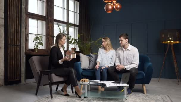 Young couple on the meeting with real estate agent.