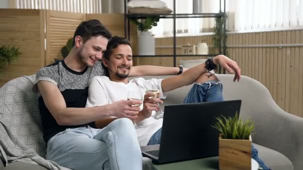 37ff617bb0 Homosexual couple, gay people, same sex marriage between Caucasian  men.Happy gay couple drinking wine while watching movie on laptop lying on  couch at ...