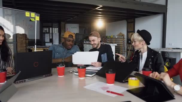 Team of young hipster working together on the new business plan.