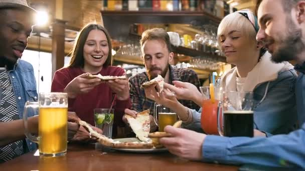 Five young hipster friends eating pizza.