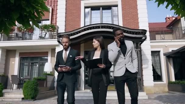 Young mixed races team of three business people talking each other about important meeting their partners of job outdoors near leaving the office