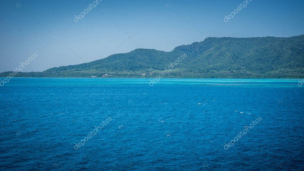 a big karimun jawa island with green landscape and beautiful blue ocean sea and green mix color in indonesia
