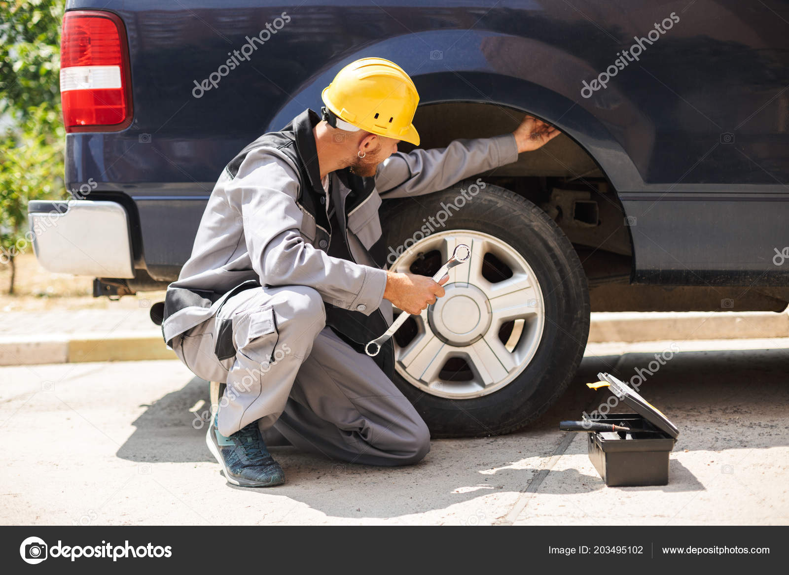 Enjoyable Young Mechanic Work Clothes Yellow Hardhat Using Wrench Home Remodeling Inspirations Basidirectenergyitoicom