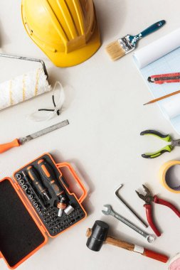 Close up modern repair tools wwith copy space in the middle over white background