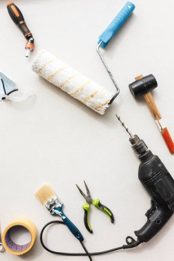 Close up variety of repair tools with copy space in the middle over white background
