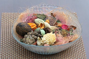 Pile of colorful potpourri in glass bowl as home decor