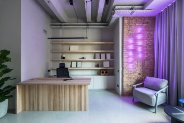 Stylish office in loft style with gray walls