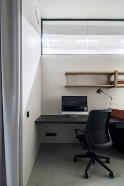 Stylish office with comfortable workplace and gray walls