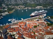 Photo Kotor bay with moored cruise ship in Montenegro